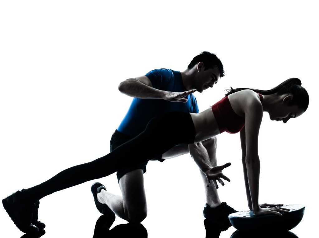 personal trainer man coach and woman exercising abdominals push ups